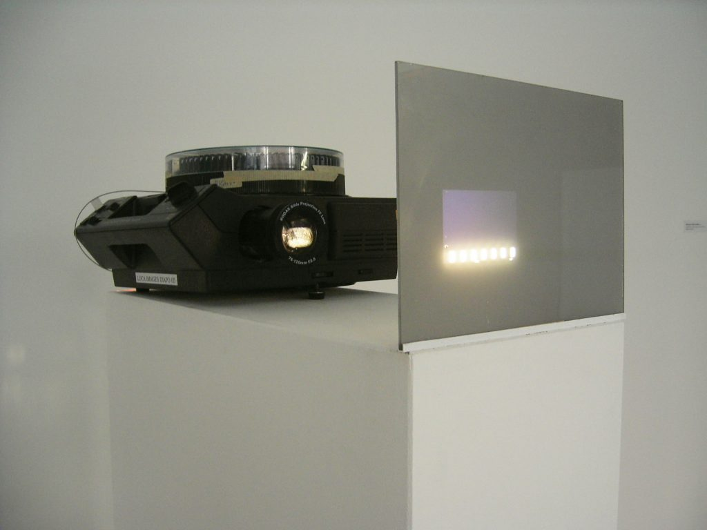 1972, slide installation, carousel projector, miniature plexiglas screen, edition of 5