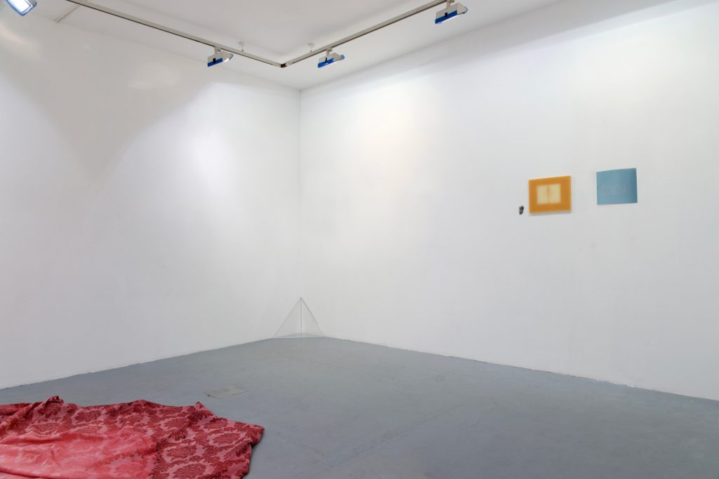 MISSIONARY ON GROUND, 2009, white cotton, red ink, 130 x 170 x 45 cm, TO THE WALL, 2011, fossil, exposed wax, unfixed photosensitive paper, dimensions variable