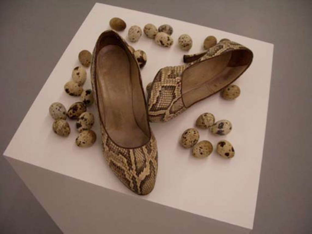 shoes, eggs on pedestal, dimensions variable