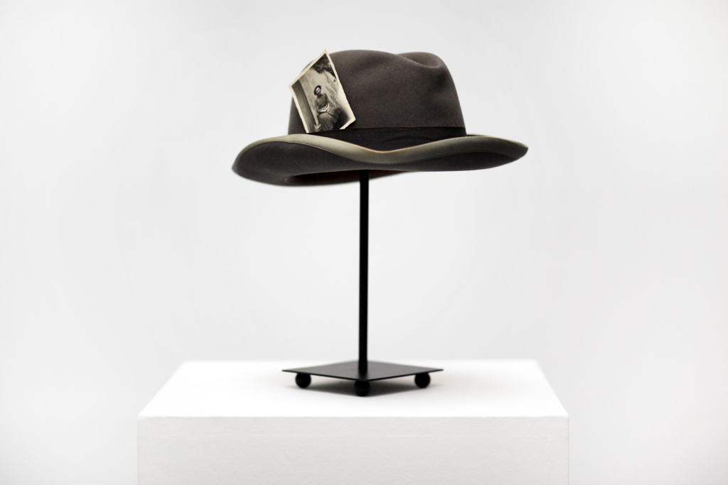 hat with photo on pedestal, 40 x 20 x 20 cm