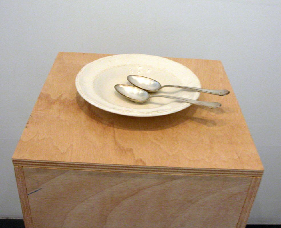 installation, 2 silver spoons, porcelain plate, dimensions variable