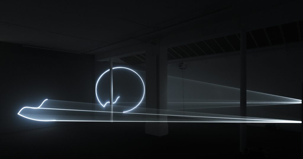 2009, A two-projector, horizontal installation, this work draws on the use of sound as an integral part of the work structure – the first work with sound silence ''Landscape for Fire'' in 1972. Each 'colonical' form is based on a single, continuous line that combines the circle, the straight line and the traveling wave. The installation is based not only on a reciprocity between these two forms – one diminishing to nothing while the other grows to full size – but also on the riddle of two contradictory sound sources on opposite sides of the space, and on the structure which draws the elements together to produce moments of complete silence when all motion ceases.