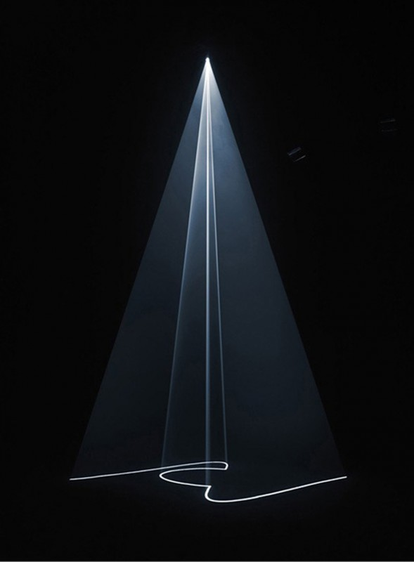 2005, installation (vertical, single), computer, computer script, video projector, haze machine, one cycle of 15 minutes, edition of 5 plus 1 AP <br> <br> A vertical (standing) deeply folded traveling wave passes through and around an only partly visible cone at its center which vigorously and repeatedly expandes and contracts.