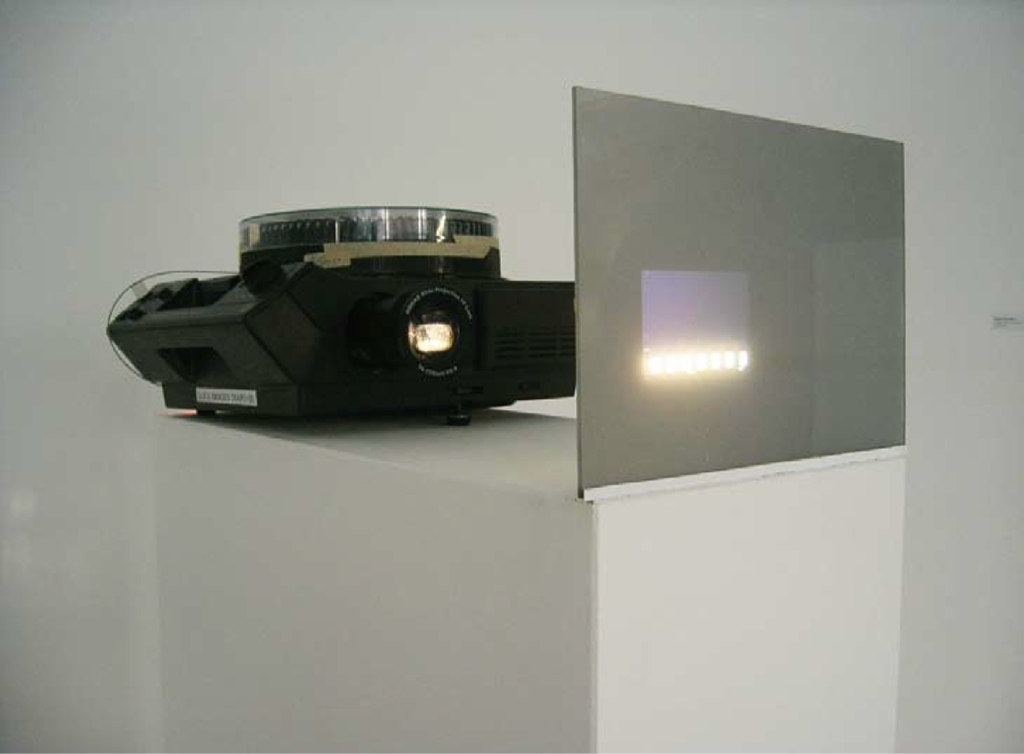 1972, installation, eighty-one 35 mm slides, carousel projector, miniature, plexiglas screen, edition of 5