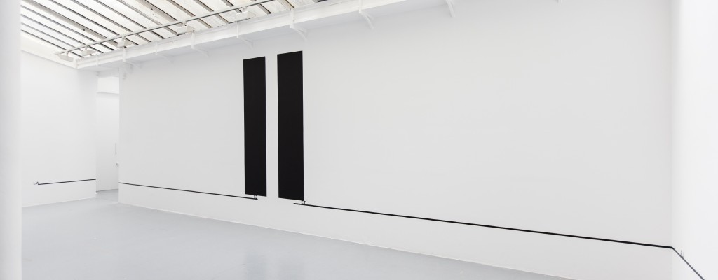 2015, wall piece, black paint, adhesive letters, black tape, dimensions variable, unique work