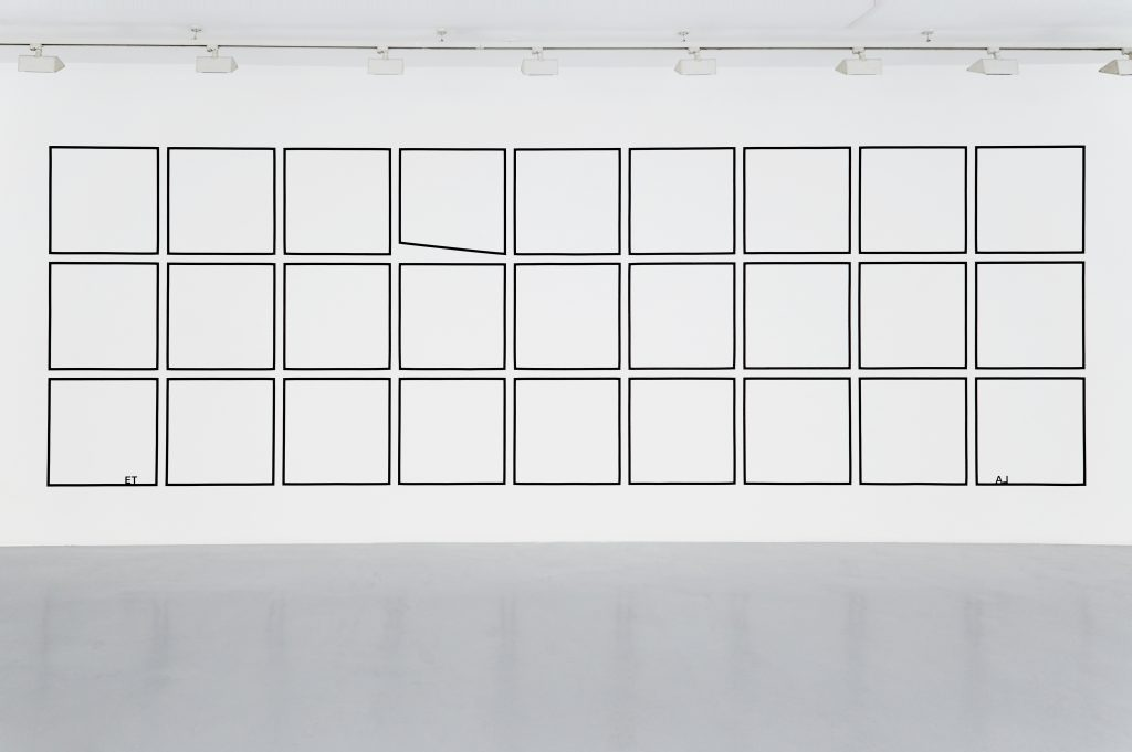 2017, wall piece, black tape, adhesive letters, three rows of nine squares, 75x75cm, one irregular trapazoid,  2.35 x 7.15 m overall, unique work Photo: Marina Gusina