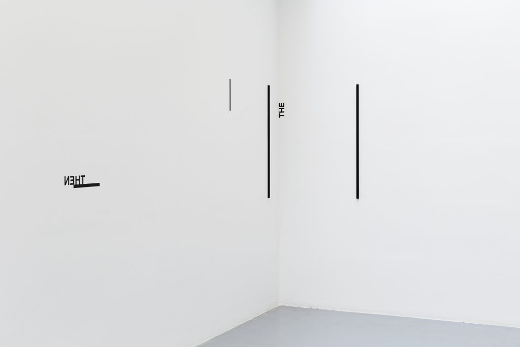 2017, wall piece, aluminum rectangular tubes, painted black, black tape, adhesive letters, tube dimensions: 15 x 20mm x 100cm, dimensions variable, unique work
