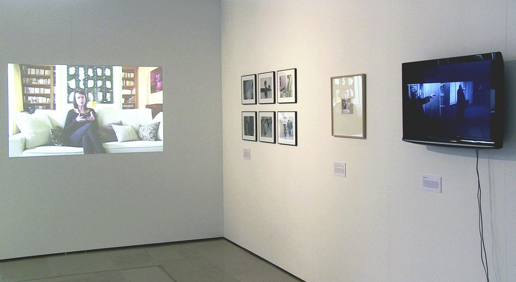 2014, installation including 6 digital photographs (20 x 27 cm), a false press clipping (12 x 16,5 cm), a film by Pierre Huyghes and refilmed by Judith Deschamps (9'46 min, video HD), a film of the art collector Dorith Galuz (7'10 min, video HD).  This installation enacts three emblematic works: Untitled Film Stills (1977-80) by Cindy Sherman; Museum Highlights (1989) by Andrea Fraser; The Third Memory (2000) by Pierre Huyghe.  I recreated them through diverse methods (false archive, photomontages, camcording).  A video assuming the codes of the documentary interview represents Dorith Galuz, a collector, in her appartment. Played by an actress, she explains the appropriation process while making reference to these works which I would have created in the 70s, 80s and 90s.