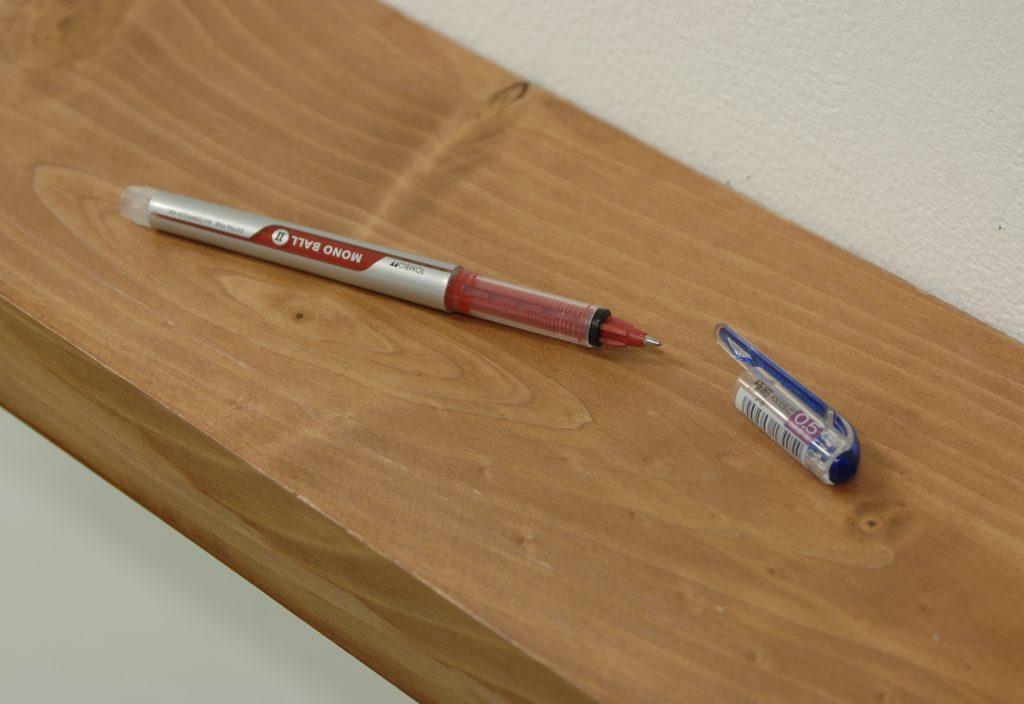 Wilfredo Prieto Infidelidad (Infidelity), 2009 Red pen, cap of blue pen, wood shelf Edition of 6 plus I AP  photo : Kei Okano